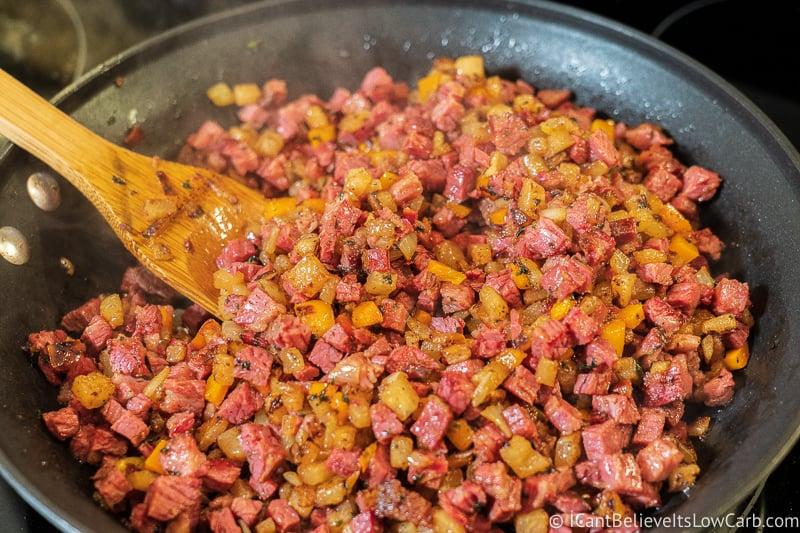 Spoonful of Keto Corned Beef Hash on the stove