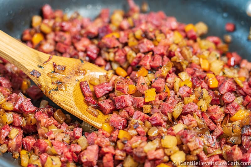 stirring Low Carb Corned Beef Hash on the stove