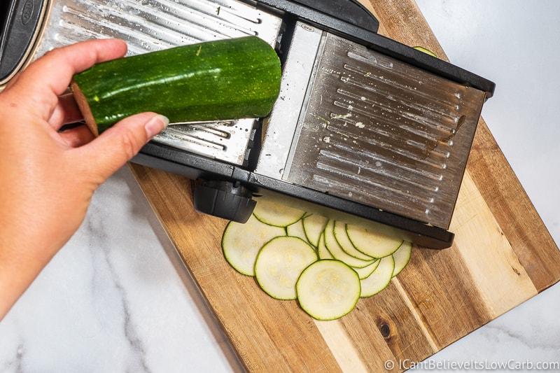 Using mandoline to slice Zucchini into Chips