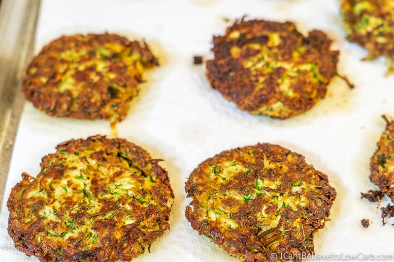 Zucchini Fritters absorbing oil on paper towels
