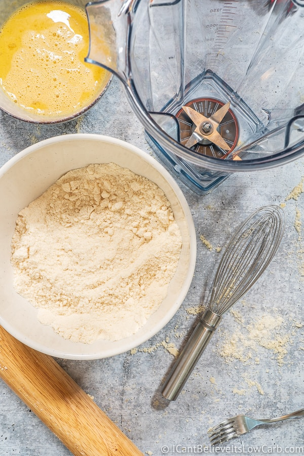 Coconut Flour Pie Crust ingredients on a bowl and a blender