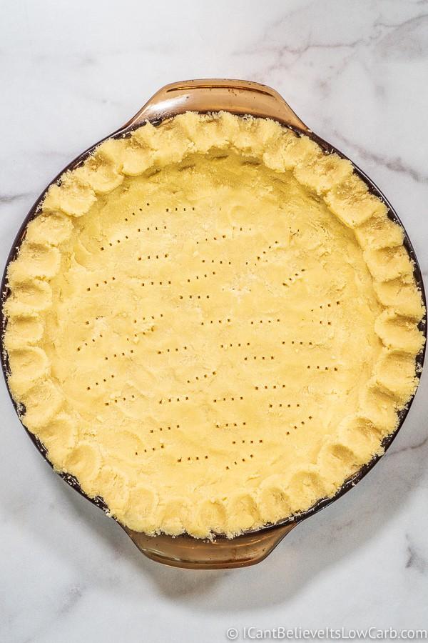 Uncooked Coconut Flour Pie Crust pressed into pie dish