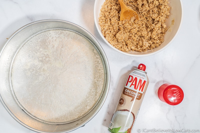 spraying cheesecake pan with Pam
