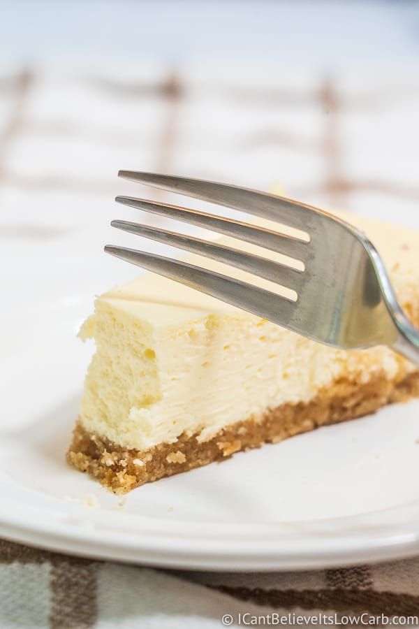 cutting Keto Cheesecake with a fork