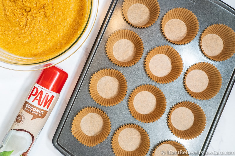 baking tray with muffin liners and Pam