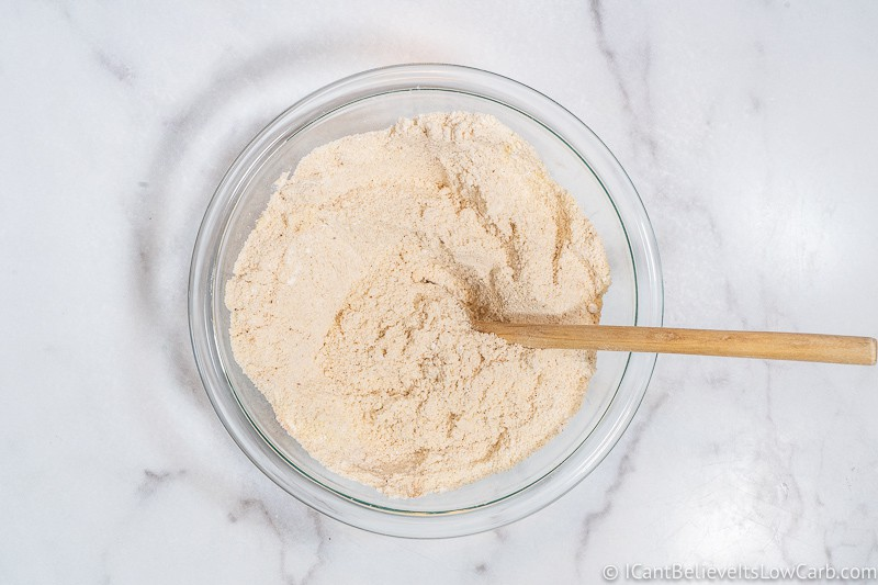 Mixing dry ingredients for Keto Pumpkin Muffins