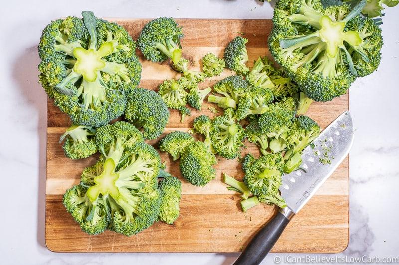 Chopping Broccoli on cutting board