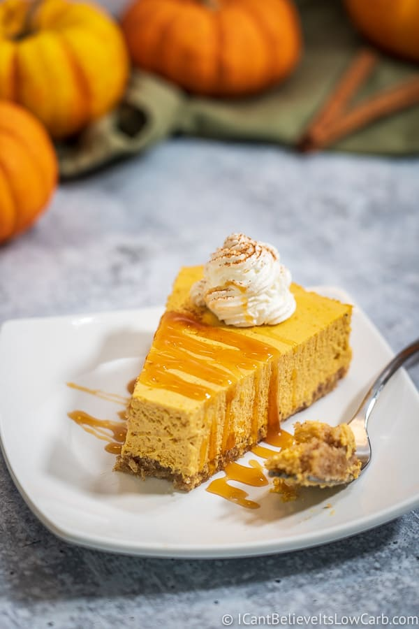 Keto Pumpkin Cheesecake with caramel sauce on white plate