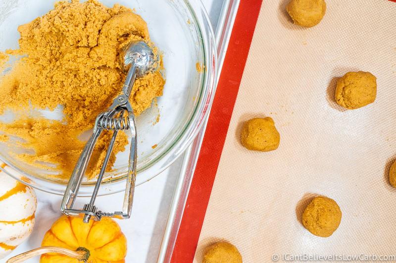 Scooping Keto Pumpkin Cookies on baking tray