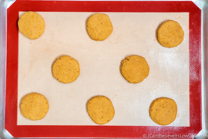 uncooked Keto Pumpkin Cookies on a baking tray after flattening