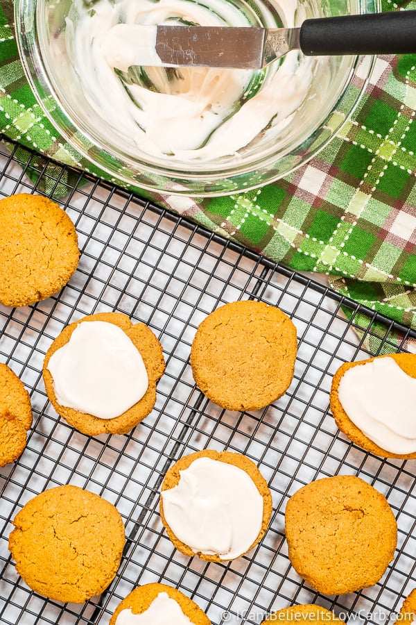 Spreading sugar free icing on Keto Pumpkin Cookies