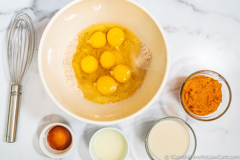 adding eggs to dry ingredients