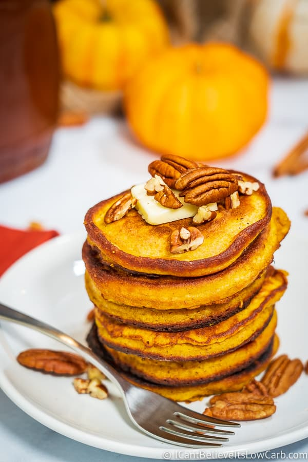 Coconut Flour Pumpkin Pancakes on plate with pecans on top