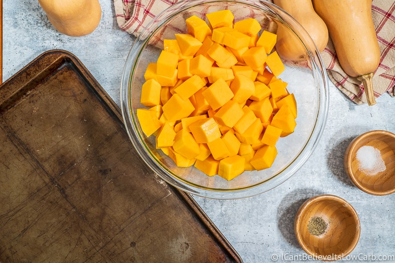 putting cubed Butternut Squash on baking tray