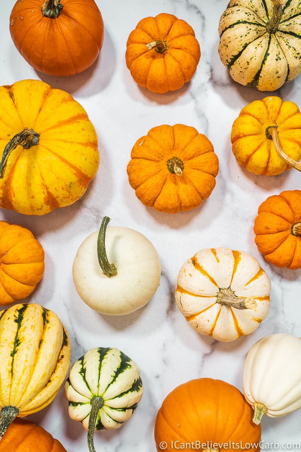 Many Pumpkins on a white table