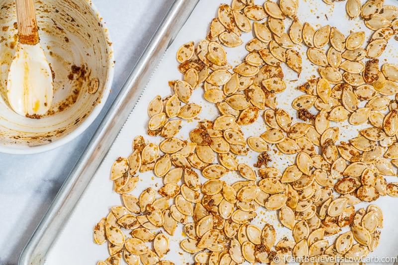 putting Italian Pumpkin Seeds on baking tray
