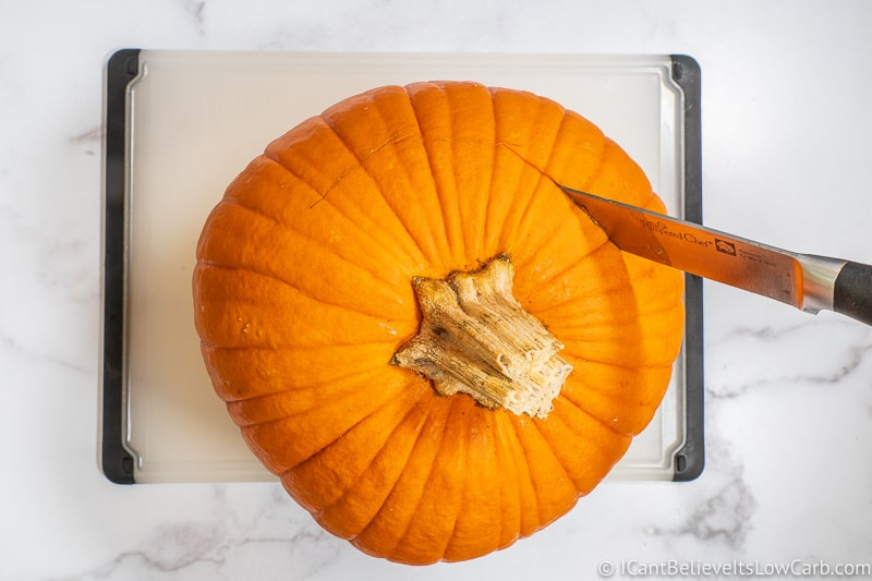 Cutting into the top of a Pumpkin