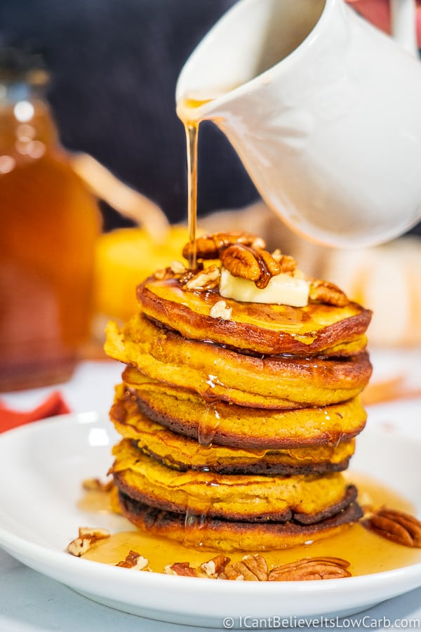 Pouring Keto Maple Syrup on pancakes