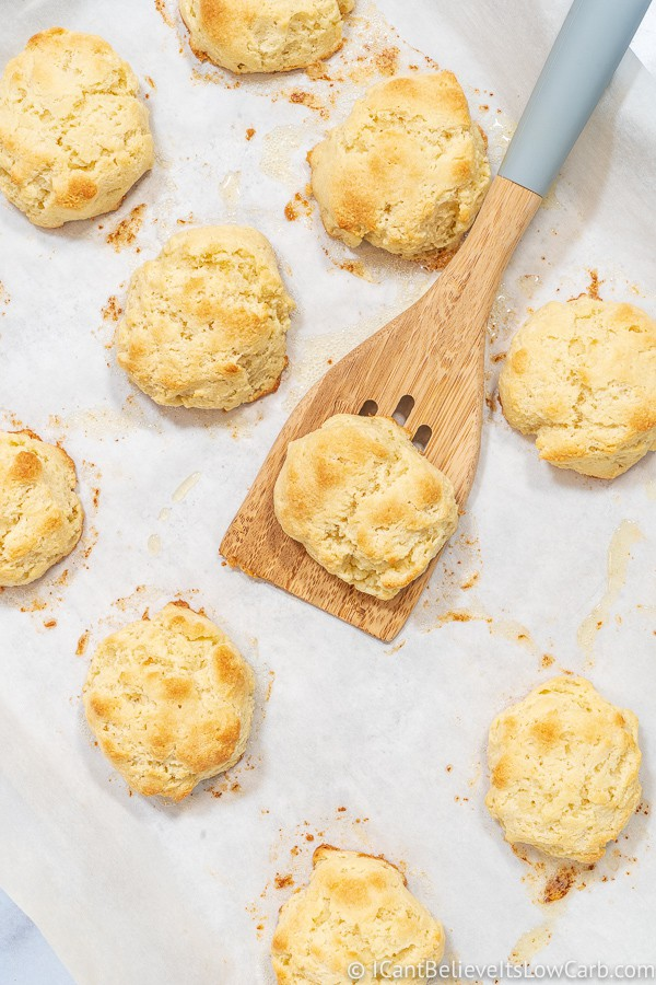 Keto Biscuits on a tray with a spatula
