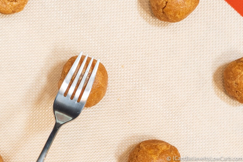 Pressing Keto Peanut Butter Cookies with a fork