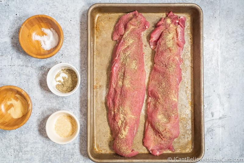 Seasoning Pork Tenderloin with garlic salt and pepper