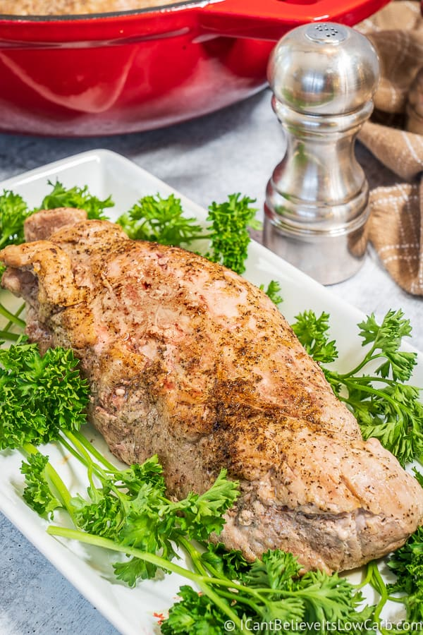 Roasted Pork Tenderloin on plate with parsley