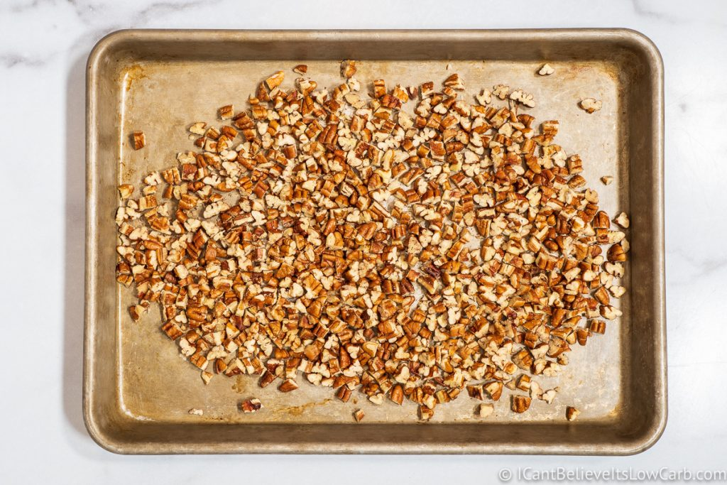 chopped pecans on a tray