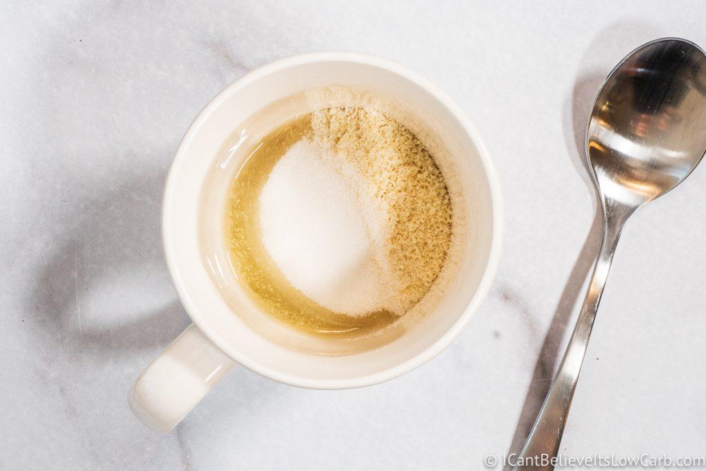 adding sweetener to mug cake