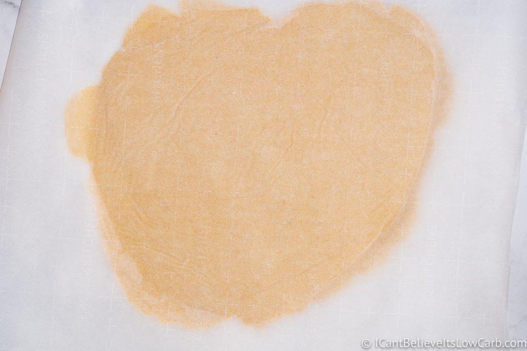 Sugar Cookie dough pressed in parchment paper
