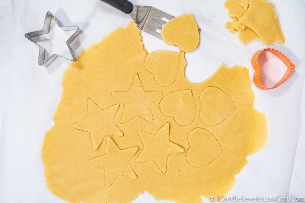 Cutting Sugar Cookie dough with cookie cutters