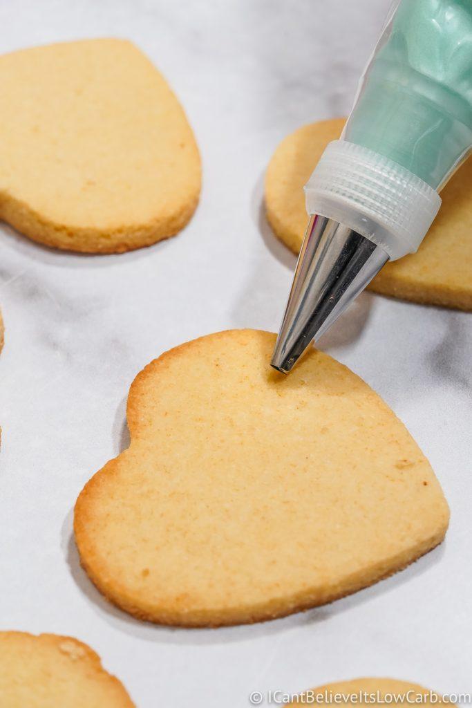 Icing Keto Sugar Cookies with piping bag