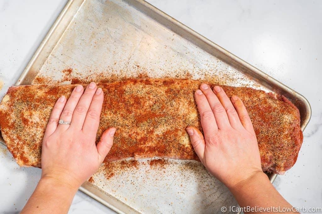 Rubbing in the seasonings on a Pork Loin