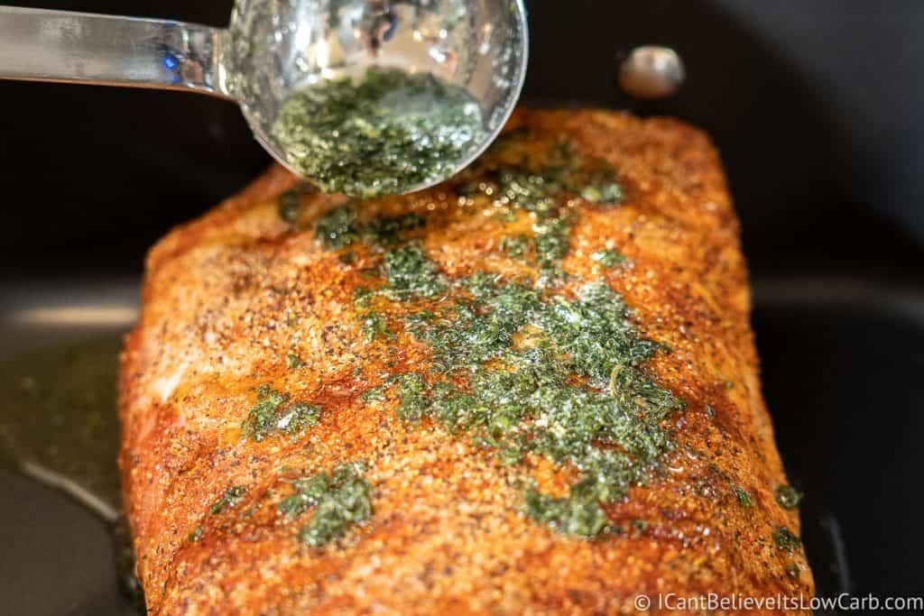 Putting butter sauce on Pork Loin Roast