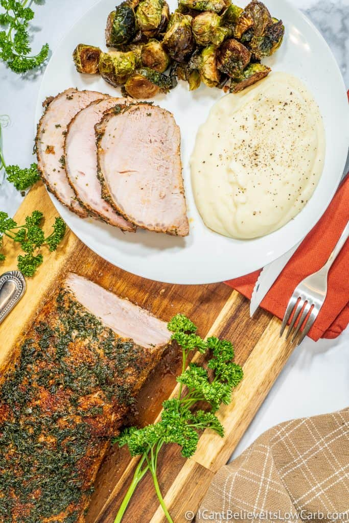 Pork Loin on a plate with cauliflower and brussel sprouts