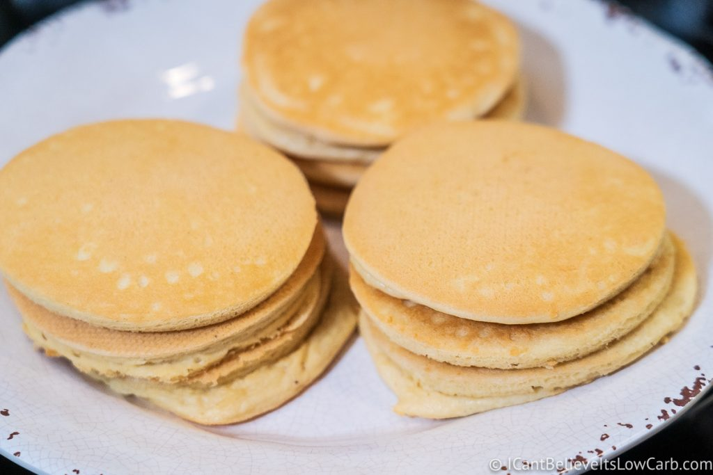 three stacks of Almond Flour Pancakes on a white plate
