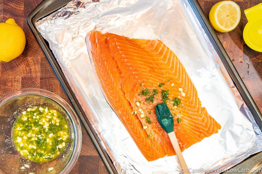 brushing lemon oil sauce on Salmon