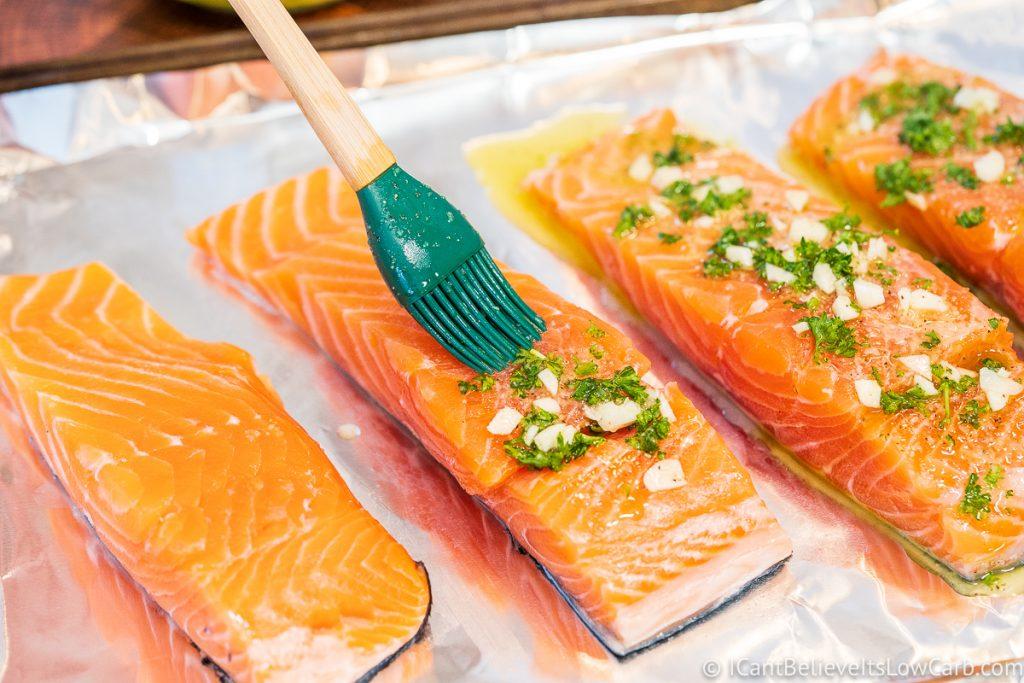 Brushing Salmon filets with garlic lemon sauce