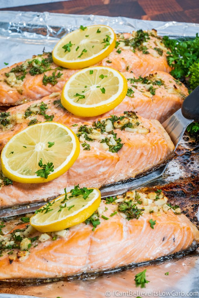 Picking up Baked Salmon filet with spatula