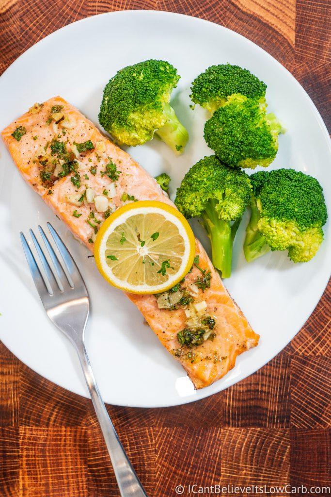 Baked Salmon on a plate with lemon and broccoli