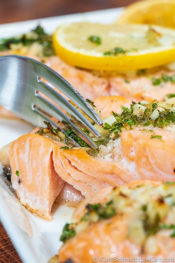 Cutting into Baked Salmon with a fork