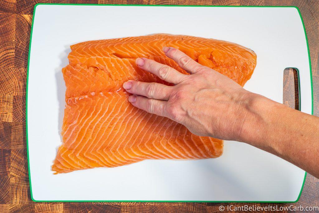 Feeling Salmon fillet for bones