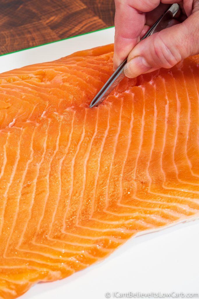 Taking pin bones out of Salmon fillet