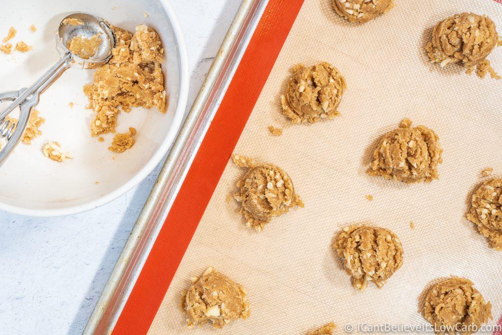 Scooping out Keto Oatmeal Cookie dough onto tray