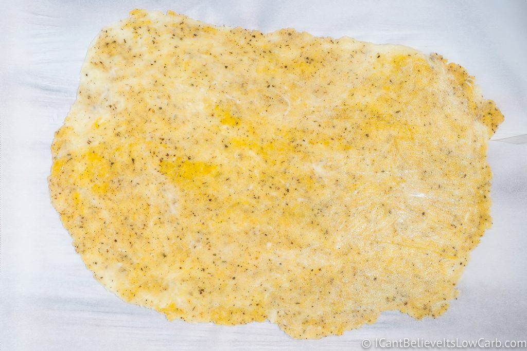 flattened keto pizza dough