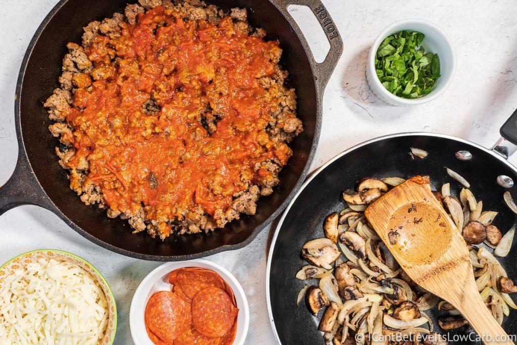 adding tomato sauce to ground sausage