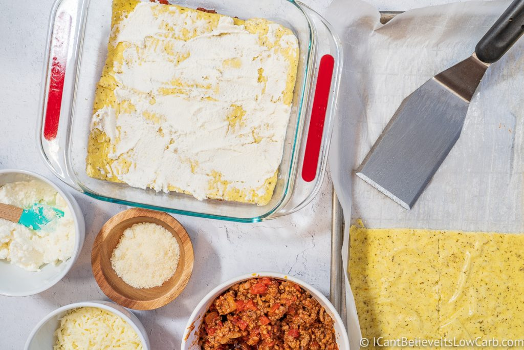 spreading cream cheese