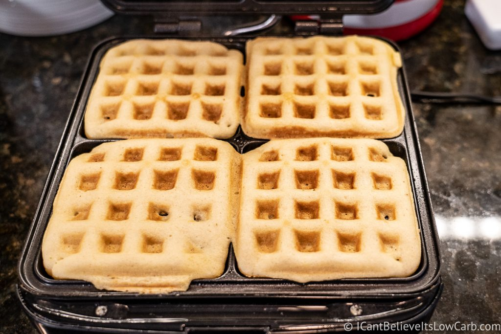 Keto Almond Flour Waffles cooking in waffle iron
