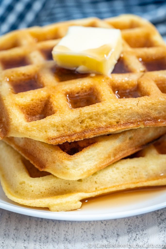 Low Carb Waffles covered in maple syrup and butter