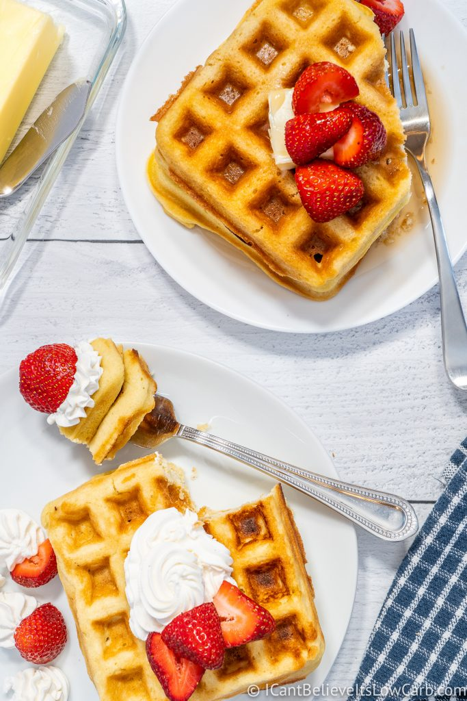 Two plates of Keto Waffles with strawberries on top