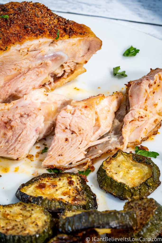 Baked Chicken Thigh cut with a knife